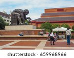 Small photo of LONDON, UK - MAY 27, 2017: Outside view of the British Library building and its concourse with the Isaac Newton sculpture by Eduardo Paolozzi and the visitors sitting and passing by.
