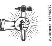 fist of worker holding hammer... | Shutterstock .eps vector #659980750