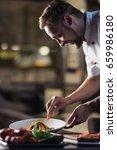 male cook preparing meals in... | Shutterstock . vector #659986180