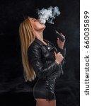 sexy woman is vaping. studio...   Shutterstock . vector #660035899