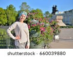 A Young Girl Stands In A Flowe...