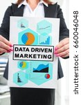 Small photo of Paper with data driven marketing concept held by a businesswoman