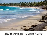 Small photo of Punta Cana, Dominican Republic - July 03, 2016: Tropical white sandy beach with palm trees. Punta Cana, what's known as La Costa del Coco, or the Coconut Coast, an area of nice, all-inclusive resorts.
