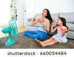 pretty mother with cute little... | Shutterstock . vector #660054484