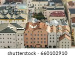 Small photo of Colorful four-story houses abut up against each other in a row along a walkway and overlook the Danube River in Passau, or Lower Bavaria in Germany