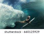 a blonde surfer girl underwater ... | Shutterstock . vector #660125929