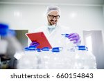 chemist doing quality control... | Shutterstock . vector #660154843