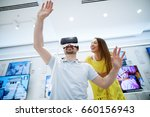 couple in electronics store ... | Shutterstock . vector #660156943