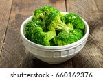 a bowl of cooked green broccoli ... | Shutterstock . vector #660162376