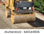 Small photo of steamroller during the asphalt laying on the road construction site