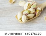 pistachio nuts are in a wooden
