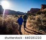 Father And Son Hiking In The...