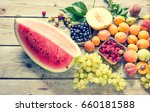 fruits on a wooden background... | Shutterstock . vector #660181588