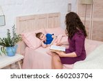 mum puts to bed a son. mother... | Shutterstock . vector #660203704