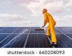labor working on cleaning solar ... | Shutterstock . vector #660208093