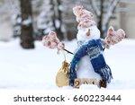 christmas snowman in warm... | Shutterstock . vector #660223444