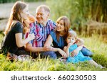happy family of four siting on...   Shutterstock . vector #660230503