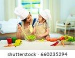 happy family mom teaching cute...   Shutterstock . vector #660235294