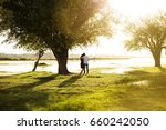 couple at sunset by the water | Shutterstock . vector #660242050