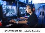 Young Girl Gamer Playing Game...
