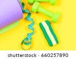 dumbbells and headband near... | Shutterstock . vector #660257890