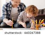 diligent boy while drawing... | Shutterstock . vector #660267388