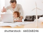 positive delighted man standing ... | Shutterstock . vector #660268246