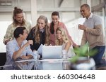 cheerful colleagues using... | Shutterstock . vector #660304648