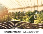 Small photo of awning over balcony terrace on sunny day