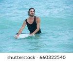 surfer man holding a surfboard  ... | Shutterstock . vector #660322540