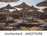 beach with umbrellas and... | Shutterstock . vector #660374398