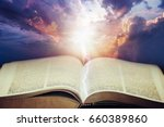 dramatic sky with open bible | Shutterstock . vector #660389860