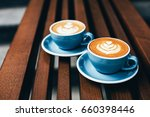 two cups of cappuccino with... | Shutterstock . vector #660398446