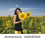 Pretty Girl With Sunflowers In...