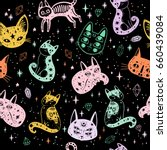 witch's cat seamless pattern.... | Shutterstock .eps vector #660439084