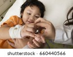 doctor examining a child with... | Shutterstock . vector #660440566