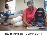 grandmother and granddaughter... | Shutterstock . vector #660441994