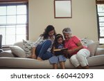 mother and daughter reading... | Shutterstock . vector #660442093
