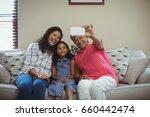 happy family taking a selfie on ...   Shutterstock . vector #660442474