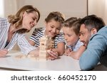 smiling family playing game at... | Shutterstock . vector #660452170