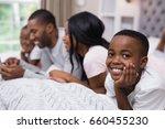 portrait of smiling boy lying... | Shutterstock . vector #660455230