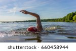 woman swimming in a lake | Shutterstock . vector #660458944