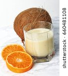 coconut and tangerine smoothie | Shutterstock . vector #660481108