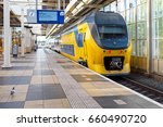 train departing from amstel... | Shutterstock . vector #660490720