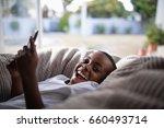 portrait of cheerful boy using... | Shutterstock . vector #660493714