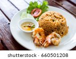 tom yam seafood fried rice ... | Shutterstock . vector #660501208
