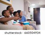 cheerful family having popcorn... | Shutterstock . vector #660504934