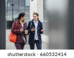 businesswomen are walking to... | Shutterstock . vector #660532414