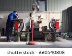worker prepares metal parts for ... | Shutterstock . vector #660540808