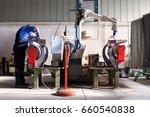 man and robotic machine work... | Shutterstock . vector #660540838